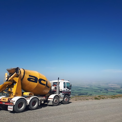 ACL Concrete Mixer with the scenic Canterbury Plains seen as it's backdrop