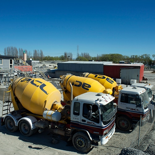 Side profile of three ACL Concrete Mixers parked beside each other